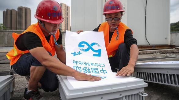 Ngấm đòn Mỹ, Huawei và ZTE trì hoãn lắp đặt trạm 5G tại Trung Quốc - Ảnh 1.