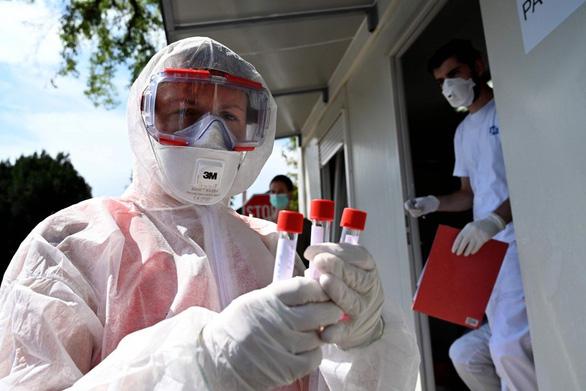 WHO: Thế giới còn cách miễn dịch cộng đồng rất xa - Ảnh 1.