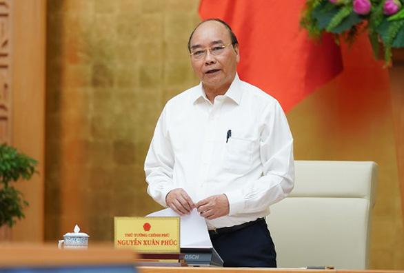Thủ tướng Nguyễn Xuân Phúc: 'Sớm sửa đổi chính sách hỗ trợ người mất việc do COVID-19 - Ảnh 1.