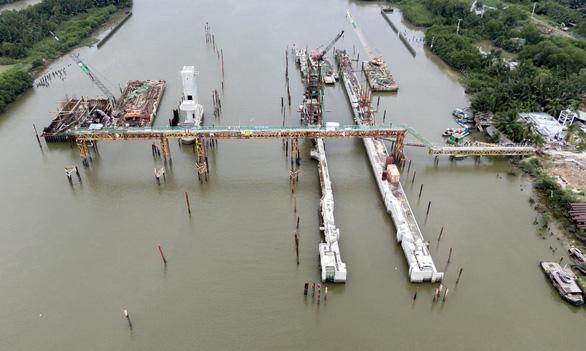 Đại dự án chống ngập ở TP.HCM dời hẹn về đích thêm 2 tháng - Ảnh 1.