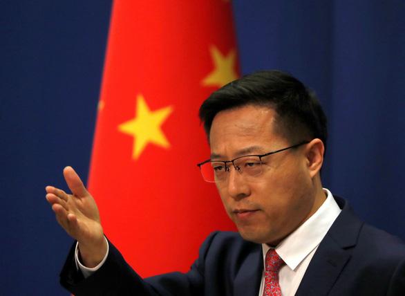 Trung Quốc yêu cầu Mỹ sửa chữa sai lầm việc trừng phạt 24 công ty xây đảo nhân tạo ở Biển Đông - Ảnh 1.