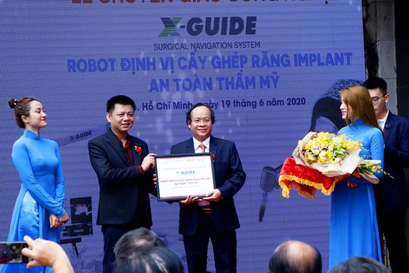 Ứng dụng robot định vị trong cấy ghép răng Implant - Ảnh 2.