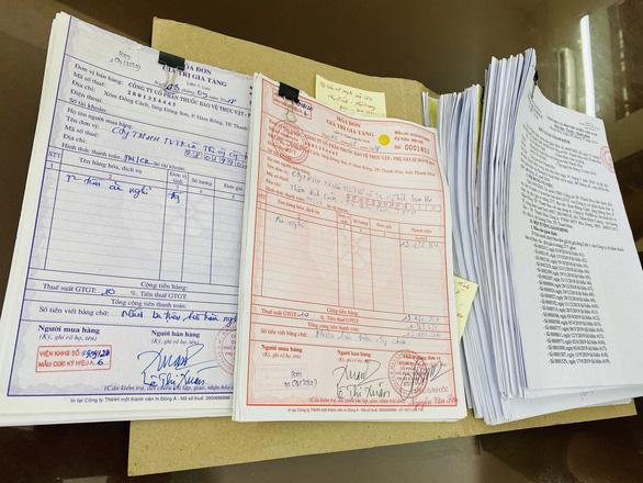 Tạm giam 3 người mua bán trái phép hóa đơn giá trị gia tăng - Ảnh 2.