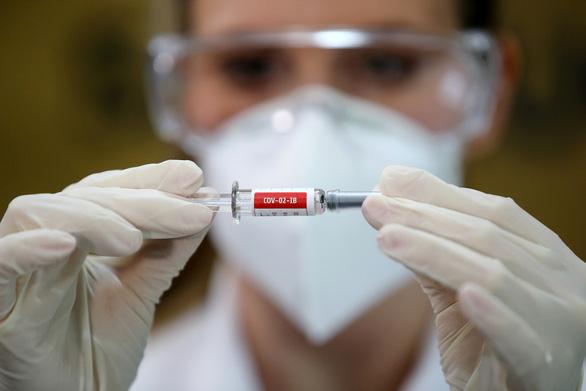Trung Quốc bắt đầu sản xuất đại trà vắc xin ngừa COVID-19 - Ảnh 1.