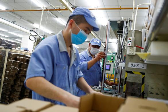 Reuters: Kinh tế Trung Quốc phục hồi nhanh hơn dự kiến - Ảnh 1.