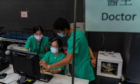 Hong Kong bác tin chuyên gia Trung Quốc thu thập ADN thông qua hỗ trợ xét nghiệm - Ảnh 1.