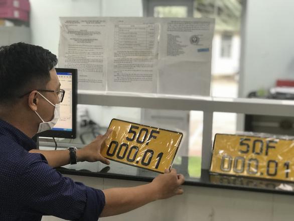 Cấp đổi biển số vàng cho xe vận tải còn vướng quy định - Ảnh 1.