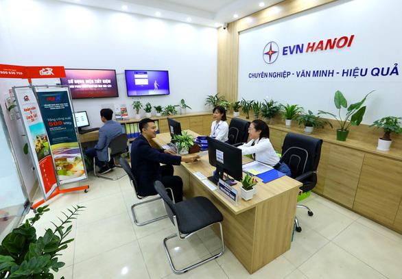 Thanh toán hóa đơn, sử dụng dịch vụ điện: Khi công nghệ thay sức con người - Ảnh 1.