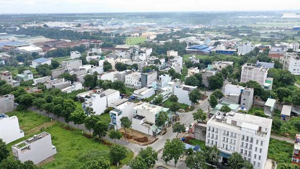 TP.HCM: Chưa sang tên, đóng tiền sử dụng đất vẫn bán nền, xây hơn 200 nhà trái phép - Ảnh 1.