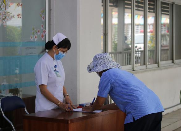 TP.HCM bỏ khai báo y tế thủ công bằng giấy - Ảnh 1.