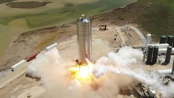 SpaceX phóng thử thành công nguyên mẫu tên lửa đưa người lên sao Hỏa - Ảnh 1.