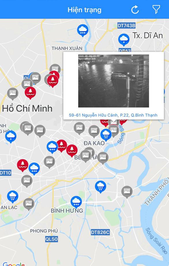Hứng trận mưa lớn nhất từ đầu năm, nhiều đường trung tâm TP.HCM ngập nặng - Ảnh 2.