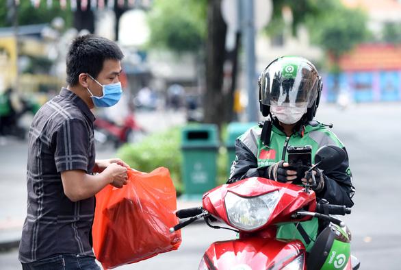 Gojek chính thức hoạt động tại Việt Nam: Tài xế vui vẻ, khách hàng hài lòng - Ảnh 6.