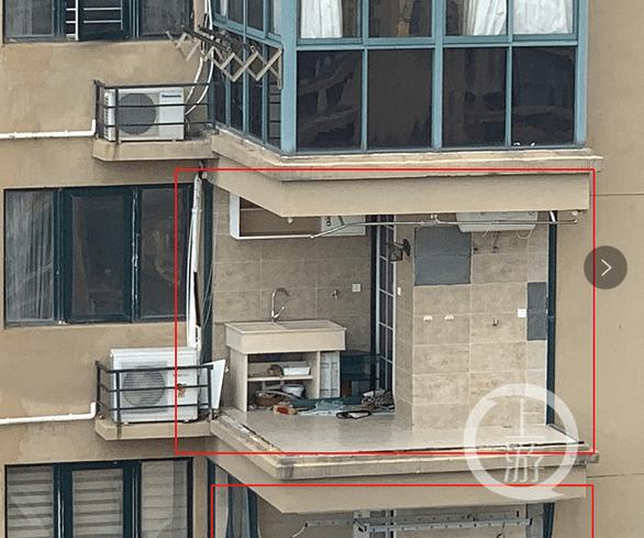 Vụ chung cư Trung Quốc bị bão xé toạc: Do lấn bancông để nhà rộng hơn? - Ảnh 1.