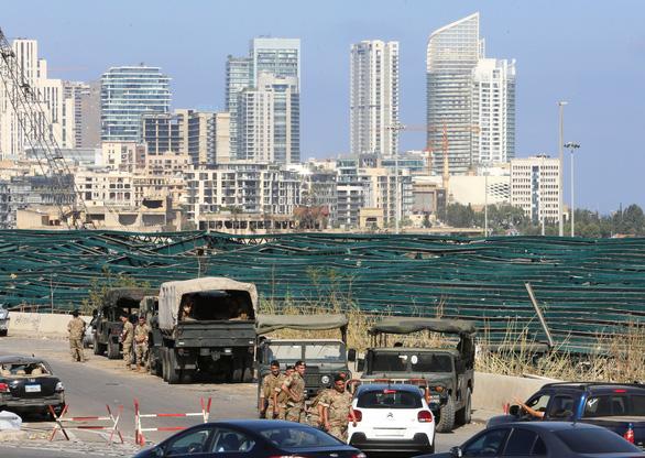 Tổng thống Lebanon: Nổ ở Beirut có thể do bên ngoài can thiệp - Ảnh 1.
