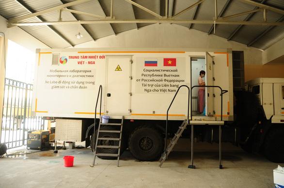 Bên trong cỗ máy xét nghiệm COVID-19 của Trung tâm Nhiệt đới Việt - Nga - Ảnh 4.