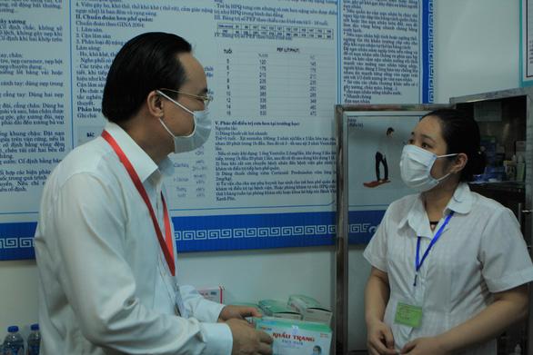 Bộ trưởng Bộ GD-ĐT Phùng Xuân Nhạ: Nỗ lực để có một kỳ thi an toàn - Ảnh 1.