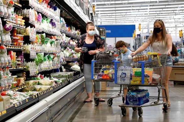 Kinh tế tiêu dùng Mỹ trồi sụt theo diễn biến dịch - Ảnh 2.