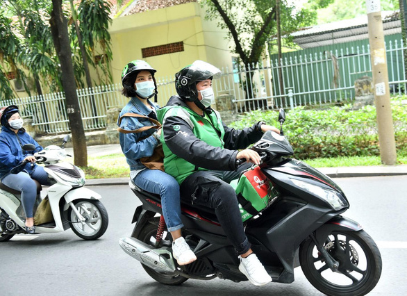Gojek Việt Nam nổi bật với màu xanh, đen đặc trưng và quốc kỳ Việt Nam - Ảnh 2.