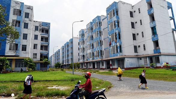 Giải cứu hơn 9.400 căn hộ tái định cư ở TP.HCM bị bỏ hoang - Ảnh 1.