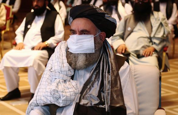 Hòa đàm bàn chấm dứt nội chiến giữa Chính phủ Afghanistan với lực lượng Taliban - Ảnh 4.