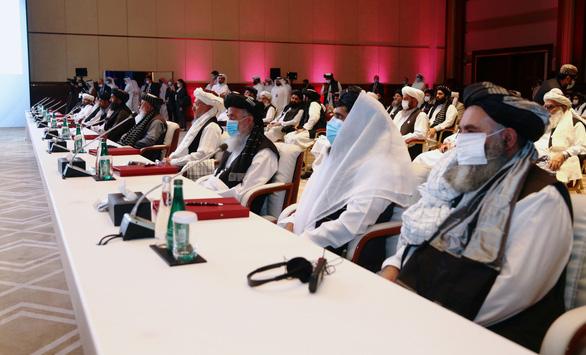Hòa đàm bàn chấm dứt nội chiến giữa Chính phủ Afghanistan với lực lượng Taliban - Ảnh 1.