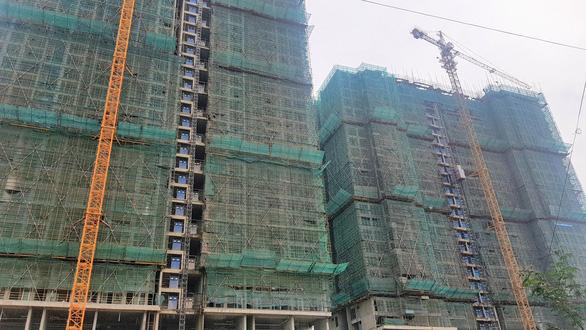 Gần 30.000 căn hộ ở TP.HCM tắc sổ hồng do tắc tiền sử dụng đất - Ảnh 2.