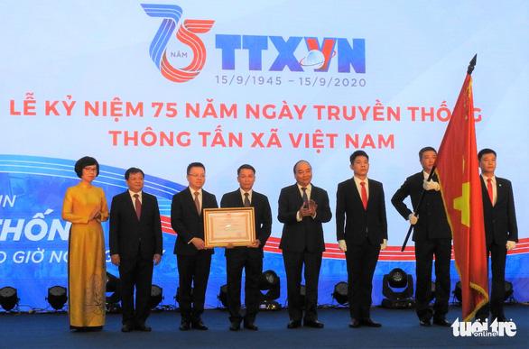 Thông tấn xã Việt Nam nhận Huân chương Lao động hạng nhất - Ảnh 1.