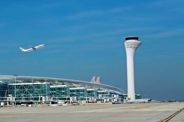 Vũ Hán có số chuyến bay và hành khách về mức trước đại dịch - Ảnh 1.