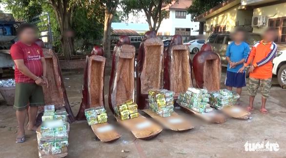 Hơn 230kg ma túy giấu trong tượng gỗ từ Lào về Việt Nam - Ảnh 3.