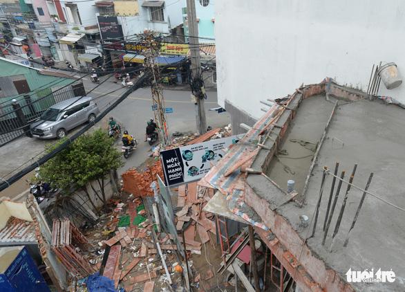 Các hộ dân tháo dỡ nhà, mở rộng nút cổ chai đường Bùi Đình Túy - Ảnh 5.