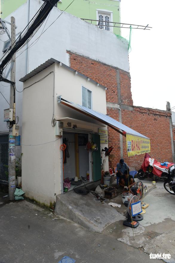 Các hộ dân tháo dỡ nhà, mở rộng nút cổ chai đường Bùi Đình Túy - Ảnh 6.