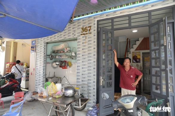 Các hộ dân tháo dỡ nhà, mở rộng nút cổ chai đường Bùi Đình Túy - Ảnh 7.