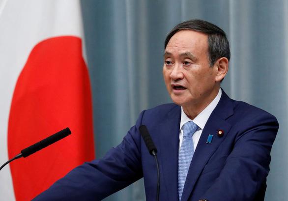Ông Yoshihide Suga: Từ con trai nông dân đến thủ tướng Nhật - Ảnh 1.