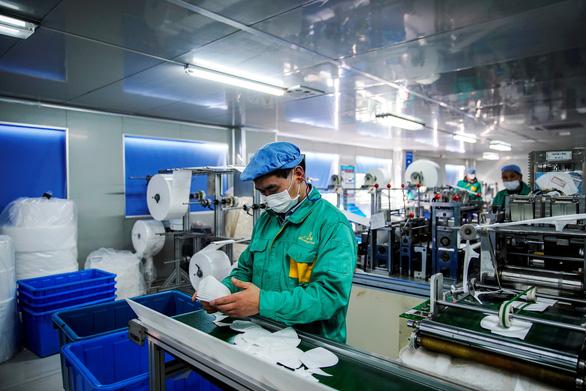 Trung Quốc tăng trưởng hậu COVID-19 song chưa vững vàng - Ảnh 1.
