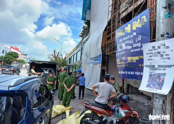 Thực nghiệm hiện trường vụ cháy chi nhánh Ngân hàng Eximbank ở Gò Vấp - Ảnh 2.