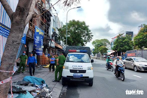 Thực nghiệm hiện trường vụ cháy chi nhánh Ngân hàng Eximbank ở Gò Vấp - Ảnh 3.
