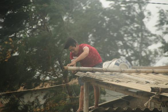 Bão số 5 vào Quảng Bình - Thừa Thiên Huế, suy yếu thành áp thấp nhiệt đới - Ảnh 9.