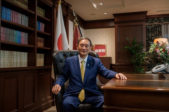 Ông Trump khen tân thủ tướng Nhật có chuyện đời tuyệt vời - Ảnh 2.