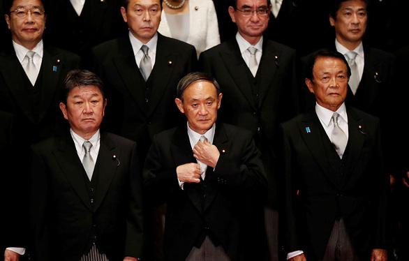 Ông Suga đi theo con đường của ông Abe? - Ảnh 1.