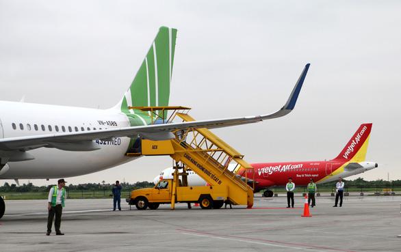 Còn nhiều vướng mắc để mở lại các chuyến bay quốc tế thường lệ - Ảnh 1.