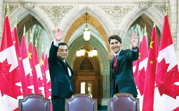 Canada từ bỏ FTA với Trung Quốc - Ảnh 1.
