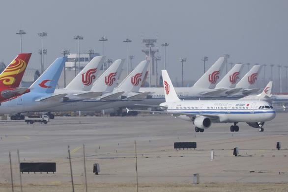 Trung Quốc nối lại một số chuyến bay quốc tế tới Bắc Kinh từ 3-9 - Ảnh 1.