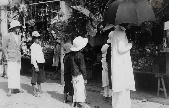 Chiếc nón lá dãi nắng dầm mưa cùng người Việt - Ảnh 4.