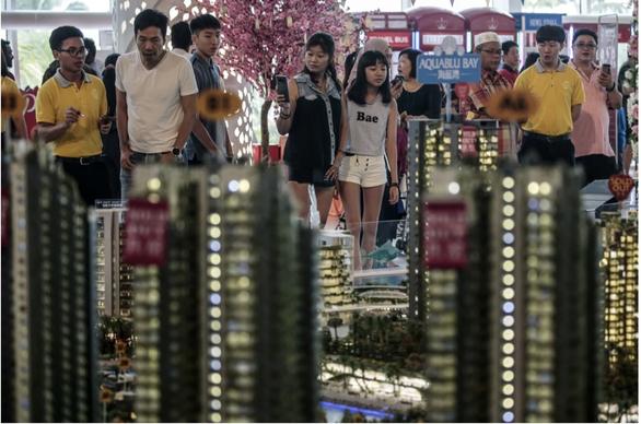 Bỏ giấc mơ ngôi nhà thứ hai, nhà đầu tư Trung Quốc bán tháo tài sản ở Malaysia - Ảnh 1.