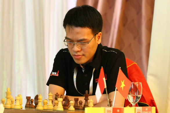 Lê Quang Liêm đánh bại đương kim vô địch cúp cờ vua thế giới - Ảnh 1.