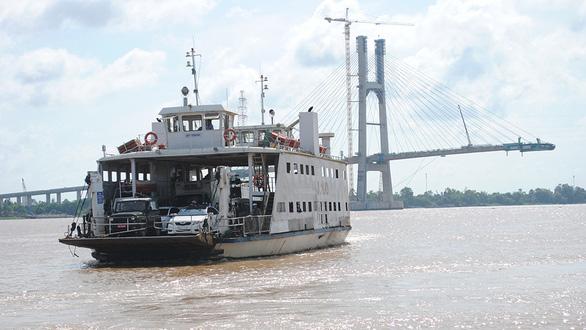 Trăm năm  lái phà đưa đón khách sang sông - Ảnh 1.