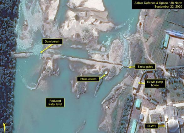Ảnh vệ tinh: Vỡ đập gần khu hạt nhân Triều Tiên - Ảnh 1.