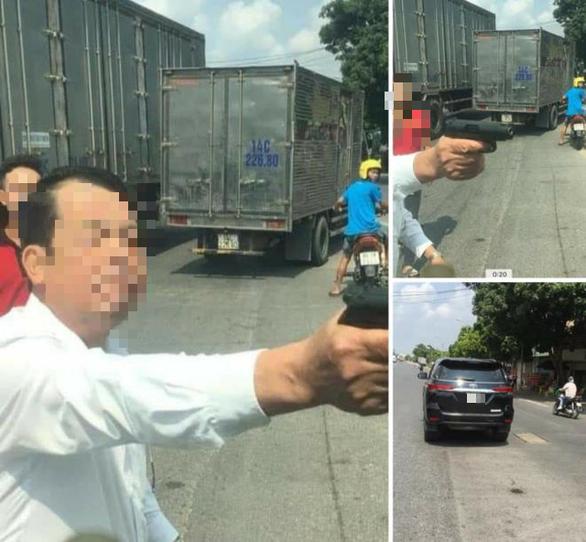 Triệu tập người đàn ông dùng súng đe dọa tài xế xe tải vì bị ép xe trên đường - Ảnh 2.