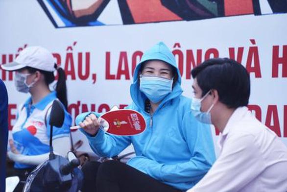 Người dân rời Đà Nẵng từ 5-9 đến TP.HCM phải tự theo dõi sức khỏe 14 ngày - Ảnh 1.